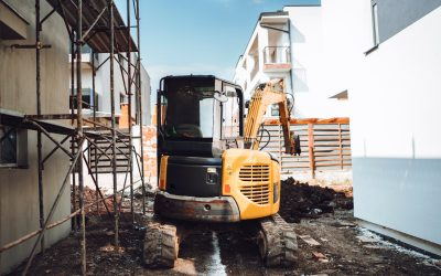 Mini heavy duty excavator moving earth for foundation building